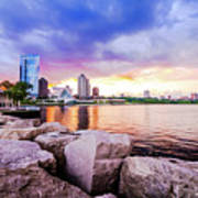 Lakefront Sunset On Rocks Poster