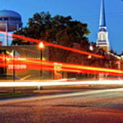 Light Trails In Front Of Bentonville Record And Water Tower Poster