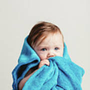Little Baby Girl Tucked In A Cozy Blue Blanket. Poster