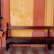Long Wooden Bench Against A Yellow Wall At The Alcazar Of Seville Poster