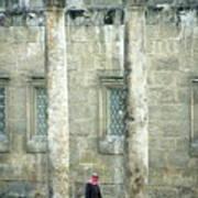 Man Walking Between Columns At The Roman Theatre Poster
