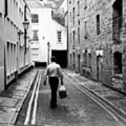Man Walking With Shopping Bag Down Narrow English Street Poster