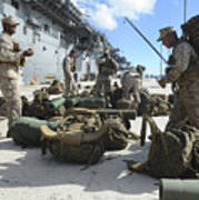 Marines Move Gear During An Embarkation Poster