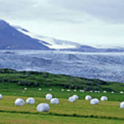 Meadow With Hay Bales And Glaciers Near Jokulsarlon Lagoon In Iceland Poster