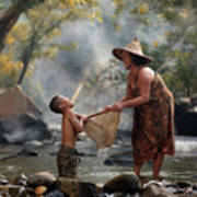 Mother And Son Are Happy With The Fish In The Natural Water Poster