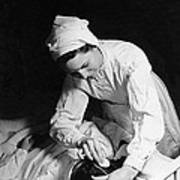 Nurse Tending To A Patient Poster