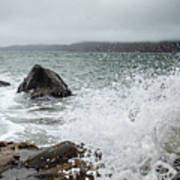Ocean Water Crashing Againt Rocks With Cloudy Skies Poster