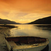 Old Rowboat At Waters Edge With Sunset Poster by Don Hammond