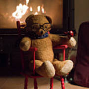 Old Teddy Bear Sitting Front Of The Fireplace In A Cold Night Poster