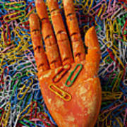 Orange Wooden Hand Holding Paperclips Poster