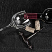 Overhead View Of Vintage Corkscrew With Red Wine Bottle And Glas Poster