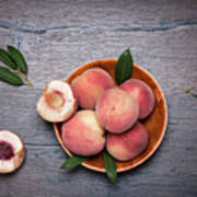 Peaches On A Dark Wooden Background Poster