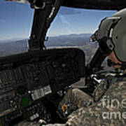 Pilot Operating The Cockpit Of A Uh-60 Poster