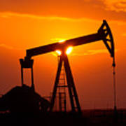 Pumping Oil Rig At Sunset Poster