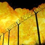 Realistic Fiery Explosion Behind Restricted Area Barbed Wire Fence Poster