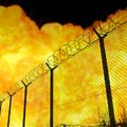 Realistic Orange Fire Explosion Behind Restricted Area Barbed Wire Fence, Blurred Background Poster
