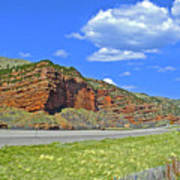Red Cliffs And White Clouds Over Interstate 80 Rest Stop In Utah  Poster