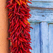 Red Peppers And Blue Door Poster