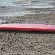 Red Surf Board On A Rocky Beach Poster