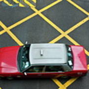 Red Taxi Cab Driving Over Yellow Lines In Hong Kong Poster