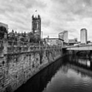 river irwell flowing between manchester on the left and salford on the right Manchester uk Poster