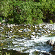 Rounded Rocks In A Rushing River Poster