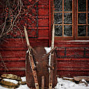 Rusty Wheelbarrow Leaning Against Barn In Winter Poster by Sandra Cunningham