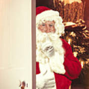 Santa Claus At Open Christmas Door Poster