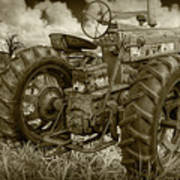 Sepia Toned Old Farmall Tractor In A Grassy Field Poster