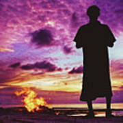 Silhouette Of A Local Man Standing By The Bonfire On The Beach In Maldives During Dramatic Sunset Poster