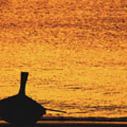 Silhouette Of A Thai Wooden Boat  On The Beach Against Golden Sunset Koh Lanta, Thailand Poster