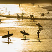 Silhouette Of Surfers At Sunset Poster