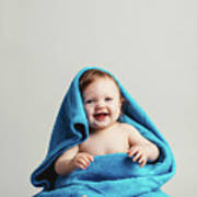 Smiling Baby Tucked In A Warm Blanket Poster