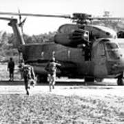 Soldiers Run To A Hh-53c Helicopter Poster