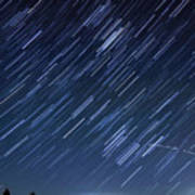Star Trails Long Exposure At Night Poster by Evan Sharboneau