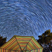 Star Trails Over The Umbrellas Poster