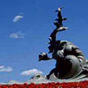 Statue And Tulips Against A Clear Blue Poster