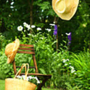 Straw Hat Hanging On Clothesline Poster by Sandra Cunningham