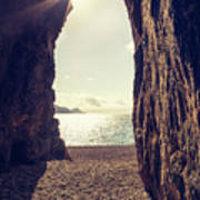 Sun Glinting Through A Cave At Bussaglia Beach In Corsica Poster