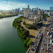 Sunrays Paint The Austin Skyline As Rush Hour Traffic Picks Up On I-35 Poster