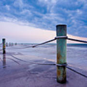 Sunset Reef Pilings Poster