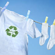 T-shirt With Recycle Logo Drying On Clothesline On A  Summer Day Poster
