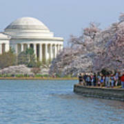 The Jefferson Memorial With Cherry Blossoms And A Lot Of People Poster