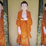 Three Buddha Statues Poster