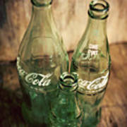 Three Vintage Coca Cola Bottles  Poster