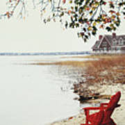 Two Chairs By The Lake's Edge In Autumn Poster