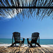 Two Chairs On Deck By Ocean Shaded By Poster