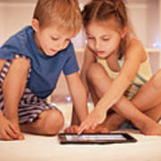 Two Happy Children Playing On The Tablet Poster