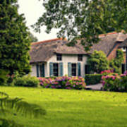 typical dutch county side of houses and gardens, Giethoorn Poster