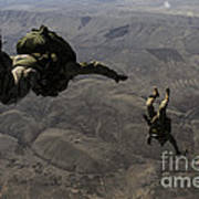 U.s. Army Soldiers Conduct A Halo Jump Poster